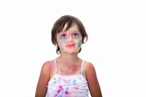 paint covered child to illustrate active learning