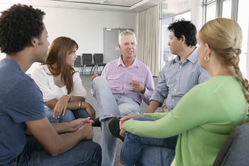 Photo of a group of faculty in discussion