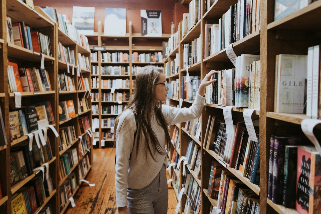 Student looking through books at bookstore