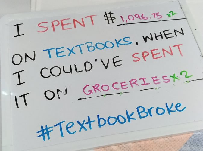 """Whiteboard with """"I spent $ on textbooks"""" when I could have spent it on food."""